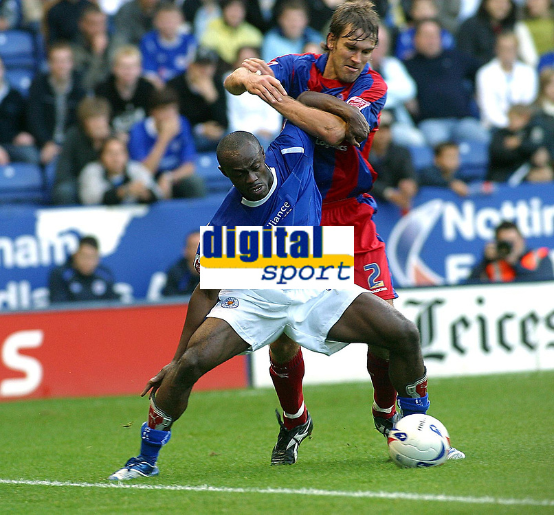 Photo: Dave Linney.<br />Leicester City v Crystal Palace. Coca Cola Championship. 21/10/2006Crystal Palaces.Elvis Hammond(L) fends off the challenge from    Matthew Lawrence