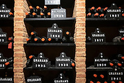 Bottles of vintage port  in racks at wine cellars of Graham's Port Lodge in V|la Nova de Gaia in Porto, Portugal