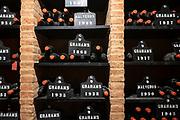 Bottles of vintage port  in racks at wine cellars of Graham's Port Lodge in V|la Nova de Gaia in Porto, Portugal