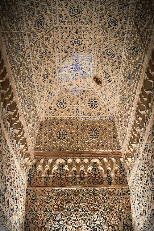 Arabesque Mudjar plaster work inside the Vestibule of Don Pedro's Palace, completed in 1366. Alcazar of Seville, Seville, Spain . The Royal Alcázars of Seville (al-Qasr al-Muriq ) or Alcázar of Seville, is a royal palace in Seville, Spain. It was built by Castilian Christians on the site of an Abbadid Muslim alcazar, or residential fortress.The fortress was destroyed after the Christian conquest of Seville The palace is a preeminent example of Mudéjar architecture in the Iberian Peninsula but features Gothic, Renaissance and Romanesque design elements from previous stages of construction. The upper storeys of the Alcázar are still occupied by the royal family when they are in Seville. <br /> <br /> Visit our SPAIN HISTORIC PLACES PHOTO COLLECTIONS for more photos to download or buy as wall art prints https://funkystock.photoshelter.com/gallery-collection/Pictures-Images-of-Spain-Spanish-Historical-Archaeology-Sites-Museum-Antiquities/C0000EUVhLC3Nbgw <br /> .<br /> Visit our MEDIEVAL PHOTO COLLECTIONS for more   photos  to download or buy as prints https://funkystock.photoshelter.com/gallery-collection/Medieval-Middle-Ages-Historic-Places-Arcaeological-Sites-Pictures-Images-of/C0000B5ZA54_WD0s