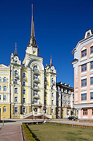 Vozdvizhenka residential real estate district in Kyiv, Ukraine. Daylight view of buildings with architectural details, portrait format. Modern architecture and comfort of living in premium location.