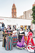 Young women dressed as a La Calavera Catrina during the Day of the Dead festival October 27, 2016 in San Miguel de Allende, Guanajuato, Mexico. The week-long celebration is a time when Mexicans welcome the dead back to earth for a visit and celebrate life.
