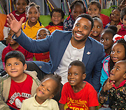 Former Houston Texan JJ Moses poses for a photograph after reading to students during a Touchdown Houston literacy program at NQ Henderson Elementary School, November 11, 2016.