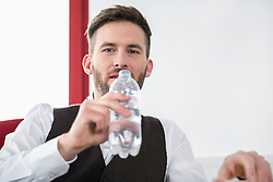 Young man office thirsty drinking water