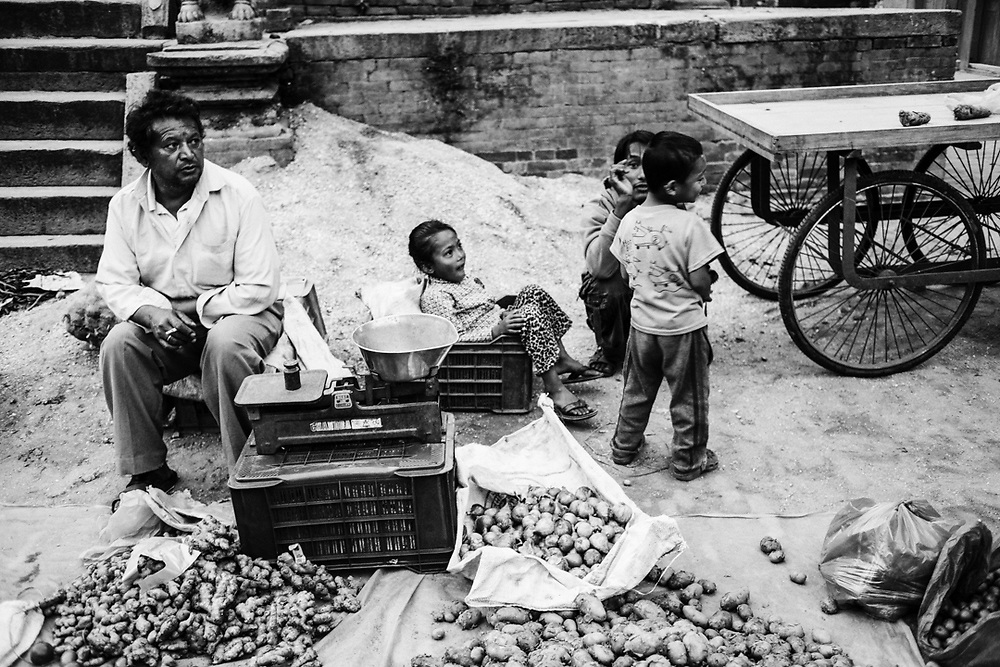 A family of sellers on the street of Bakthapur, nepal. Photo by Lorenz Berna