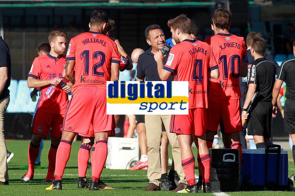 Real Sociedad's coach Eusebio Sacristan with his players during cooling break in La Liga match. August 19,2017. (ALTERPHOTOS/Acero)