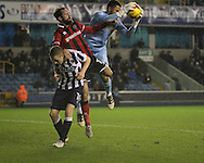 Jordan Archer of Millwall and James O'Brien of Shrewsbury Town during the Sky Bet League 1 match at The Den, London<br /> Picture by Richard Brooks/Focus Images Ltd 07947656233<br /> 10/12/2016