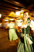 A girl serving beer during the whirlwind that is Oktoberfest in Munich, Germany.