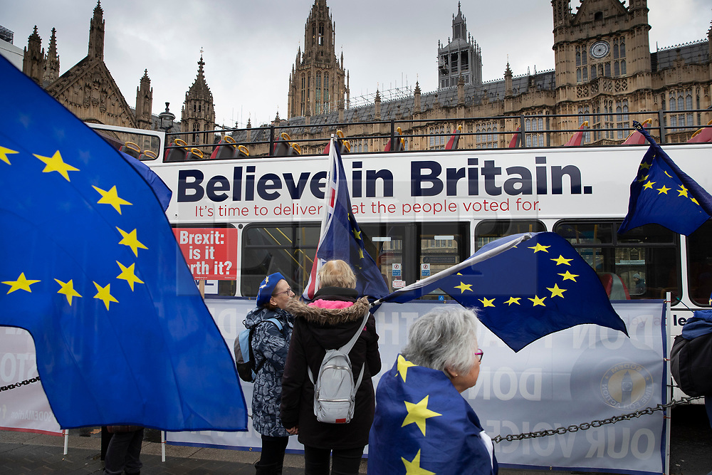 © Licensed to London News Pictures. 05/12/2018. London, UK. London, UK. Pro-EU demonstrators outside Parliament wave flags as a bus passes with a slogan in support of Brexit. Today the House of Commons debates on the Brexit withdrawal agreement for the second day ahead of the meaningful vote. Photo credit: Peter Macdiarmid/LNP