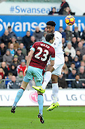 Swansea's Leroy Fer (r) challenges Burnley's Stephen Ward (23) to a header. Premier league match, Swansea city v Burnley at the Liberty Stadium in Swansea, South Wales on Saturday 4th March 2017.<br /> pic by  Carl Robertson, Andrew Orchard sports photography.