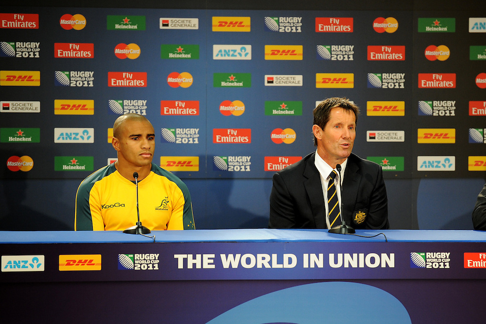 Will Genia and Robbie Deans at the press conference following the Pool C, Australia v USA match at the IRB Rugby World Cup 2011. Wellington Regional Stadium, Wellington. Friday 23 September 2011...Photo: Mark Tantrum/photosport.co.nz..