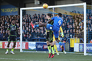 AFC Wimbledon defender Deji Oshilaja (4) winning a header in the box during the EFL Sky Bet League 1 match between AFC Wimbledon and Bristol Rovers at the Cherry Red Records Stadium, Kingston, England on 17 February 2018. Picture by Matthew Redman.