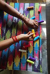 Anita Nepali, weaving a Dhaka Shawl, <br />MEDEP supported Dhaka Weaving Centre, Patichaur, Ward 9 Deupur VDC  Pokhara, Nepal.