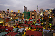 A section of the skyline of Taipei, Taiwan  from the roof of the Taipei Fullerton Hotel. The tall building is Taipei 101, one of the world's tallest buildings.