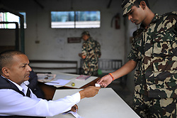 October 7, 2018 - Kathmandu, NP, Nepal - Staff of Nepal Rastra Bank give token to exchange new notes for the Biggest Dashain Festival in Kathmandu on Sunday, October 07, 2018. The central bank said for general public can exchange as much as Rs 27,000 each from its Currency Management Division. (Credit Image: © Narayan Maharjan/NurPhoto/ZUMA Press)