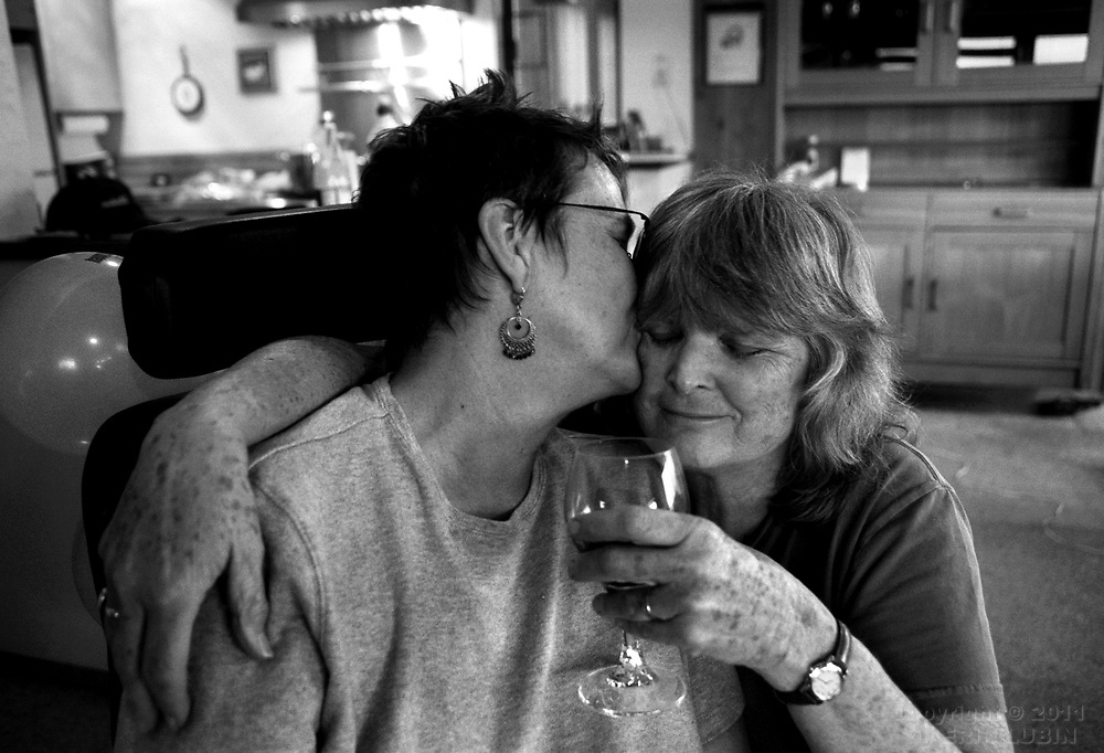 Karen Jorgensen ended her life in July of 2007 after five years of slow debilitation brought on by Amyotrophic Lateral Sclerosis, ALS or, Lou Gehrig's disease. The photos in this gallery are of Jorgensen's life with her partner, Karen Toloui, during the years they lived with the fatal illness. Jorgensen's family buried her ashes at a cemetery in Berkeley, CA in January of 2008...Karen and Karen celebrate Jorgensen's sixty-first birthday at a rented home in Sea Ranch, CA in September 2003...Photographs by Erin Lubin