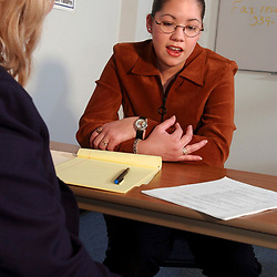 Austin, Texas:   IMPROPER INTERVIEW TECHNIQUE demonstrated by lack of eye contact by Hispanic twenty-one year old woman interviewing for job at Worksource Career Center.  January 2002 ©Bob Daemmrich
