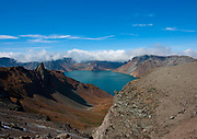 """PAEKTU, LAND OF NORTH KOREAN LEGENDS<br /> <br /> Mount Paektu volcano is considered a holy place for North Koreans. It is deemed the place of origin for them. The country's founding father Kim Il- Sung commanded anti-Japanese guerrilla in the 50's from a secret camp in this place.<br /> North Korea says his son Kim Jong-il was born there in 1942. He was actually born in Siberia, where his father had taken refuge from Japanese troops.<br /> The dear Leaders are said to have a """"mount Paektu bloodline ». A famous slogan says: « Let us all turn out in the general offensive to hasten final victory in the revolutionary spirit of Paektu! »<br /> A new probelm may erupt: when North Korea tests a nuclear weapon, specialists say the energy could trigger a volcanic...eruption in Paektu. That could be a huge disaster, killing thousands in North Korea and on the chinese side too.<br /> <br /> Photo shows: The view at the top is breathtaking. Paektu is an active volcano which last erupted in 1903. 1000 years ago Paektu was the place of one of the biggest eruptions in human history. The huge explosion caused the volcano's crater to collapse, forming the Chon lake called.<br /> ©Eric Lafforgue/Exclusivepix Media"""