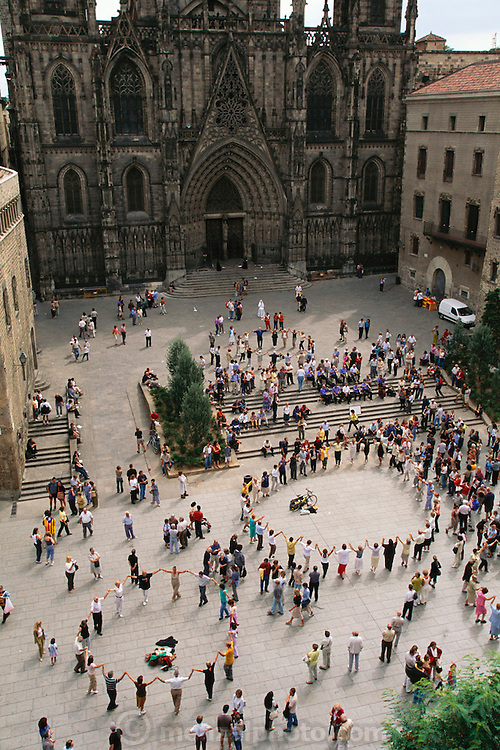 Dancing La Sardana (Catalan folk dance) in front of the Gothic Cathedral (built 13th to 15th Century) in Barcelona, Spain.