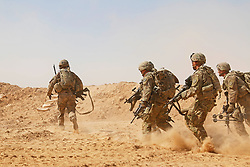 U.S. Soldiers assigned to the 3rd Cavalry Regiment and deployed in support of Combined Joint Task Force – Operation Inherent Resolve (CJTF-OIR) rush to a berm to establish a hasty fighting position during a live-fire training exercise near Al Asad Air Base (AAAB), Iraq, Sept. 26, 2018. AAAB is a CJTF-OIR enhanced partner capacity location dedicated to training partner forces and enhancing their effectiveness. (U.S. Army National Guard photo by 1st Lt. Leland White)