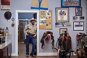 Larry Callies owner of the Black Cowboy Museum in Rosenberg, TX poses for a portrait in one of the museum rooms Friday February 15, 2019.