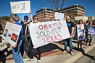 """February 17th, 2013, Melanie Scruggs, part of the Texas Campaign for the Environment holds a sign saying """"Obama sold out Texas"""", is part of a group<br /> of over 300 protester against the Keystone XL Pipeline gathering in front of a Whole Foods store in Austin, Texas in solidarity with protesters in <br />  Washington DC where tens of thousands showed up for the largest climate change rally protest in the environmental movement's history. A coalition of environmental groups took place in the actions including , the Sierra Club, 350.org, and the Tar Sands Blockade."""