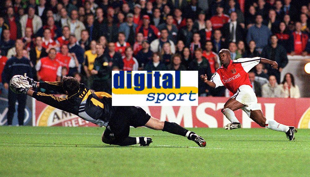 Sylvian Wiltord has his shot saved by Shakhar Donetsk goalkeeper Yurii Virt. Arsenal 3:2 FC Shakhar Donetsk, UEFA Champions League, Group B, 20/9/2000. Credit Colorsport / Paul Roberts
