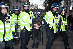 © under license to London News Pictures. 9/12/2010. A man is led away by police. On the day that MPs vote on tuition fees, 1000s demonstrated in London against a proposed rise in fees and cuts in support. Credit should read Matt Cetti-Roberts/London News Pictures