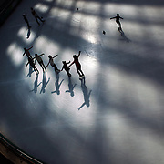 Patterns of light and shade cover the ice at Lotte World Indoor Ice Rink, Seoul, Korea, as young aspiring South Korean girls train under the watchful eye of their coaches. Figure skating has huge popularity in South Korea, particularly after the success of South Korean figure skater Kim Yu-Na who won the Ladies' Singles Gold Medal at the 2010 Winter Olympic games. Seoul, South Korea. 21st March 2012. Photo Tim Clayton
