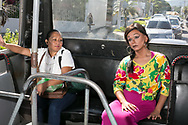 """Nadia (Javier Ramírez), a drag queen, rides the 30B bus in San Salvador, El Salvador on October 30, 2017. Riding the bus in drag is extremely dangerous for Nadia since<br /> El Salvador's crime rate against the LGBTQIA community has drastically increased but it is her only means of transportation. """"One time I was in the bus in the clothes of a boy and that man feel so threatened from my pink socks he show me the knife. He wasn't even bad guy, he just scared,"""" Nadia said. Right now she is 32 years old but according to statistics her average life expectancy as a gender non-conforming person in El Salvador is just 35, giving her only three more years to live. (photo by Caroline Lacey)"""