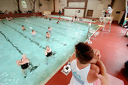 An unidentified lifeguard, right, leads a water aerobics class at the Plunge in Hayward, Calif., Monday, Aug. 7, 2000. (Photo by D. Ross Cameron)