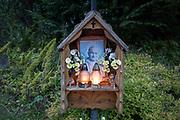 Candles burn in a shrine to Polish-born Pope John Paul II, on 16th September 2019, in Koscielisko, Zakopane, Malopolska, Poland. Jan Pawel II; born Karol Jozef Wojtyla (1920-2005) was head of the Catholic Church and sovereign of the Vatican City State from 1978 to 2005.