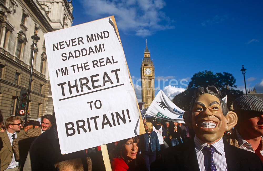 A protester with the rural pressure group Countryside Alliance wears a mask of Prime Minister Tony Blair marches through Westminster against the threat against the fox hunting ban, on 22nd September 2002, in Parliament Square, London, England.