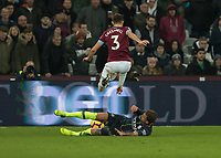 Football - 2018 / 2019 Premier League - West Ham United vs. Manchester City<br /> <br /> Aaron Cresswell (West Ham United) leaps over the sliding body of Kyle Walker (Manchester City) at the London Stadium<br /> <br /> COLORSPORT/DANIEL BEARHAM