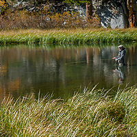 A woman casts for trout in Bishop Creek in the Eastern Sierra Nevada above Bishop, California.