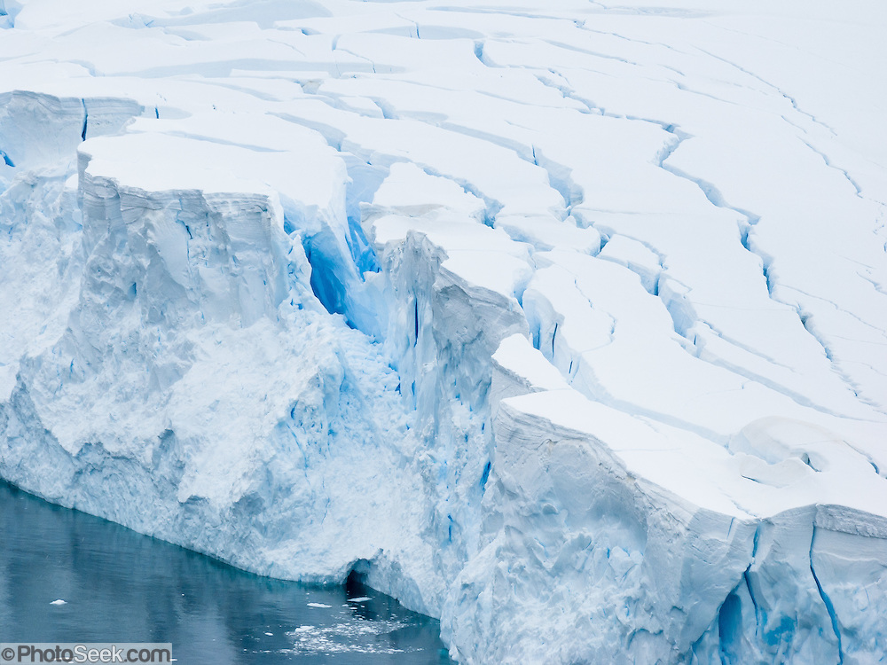 A tidewater glacier cracks crevasse patterns at Neko Harbor (Southern Ocean), Graham Land, the north portion of the Antarctic Peninsula, in Antarctica.