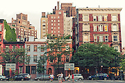 Editorial travel photography: Kids playing basketball in a playground in chelsea district, Manhattan, New York City, USA