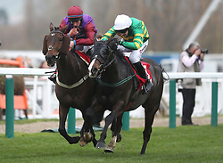 Josies Orders ridden by Mark Walsh (right) with Fact of the Matter ridden by Gavin Sheehan (left) on their way to victory in the Glenfarclas Cross Country Handicap Chase during day one of the November Meeting at Cheltenham Racecourse.