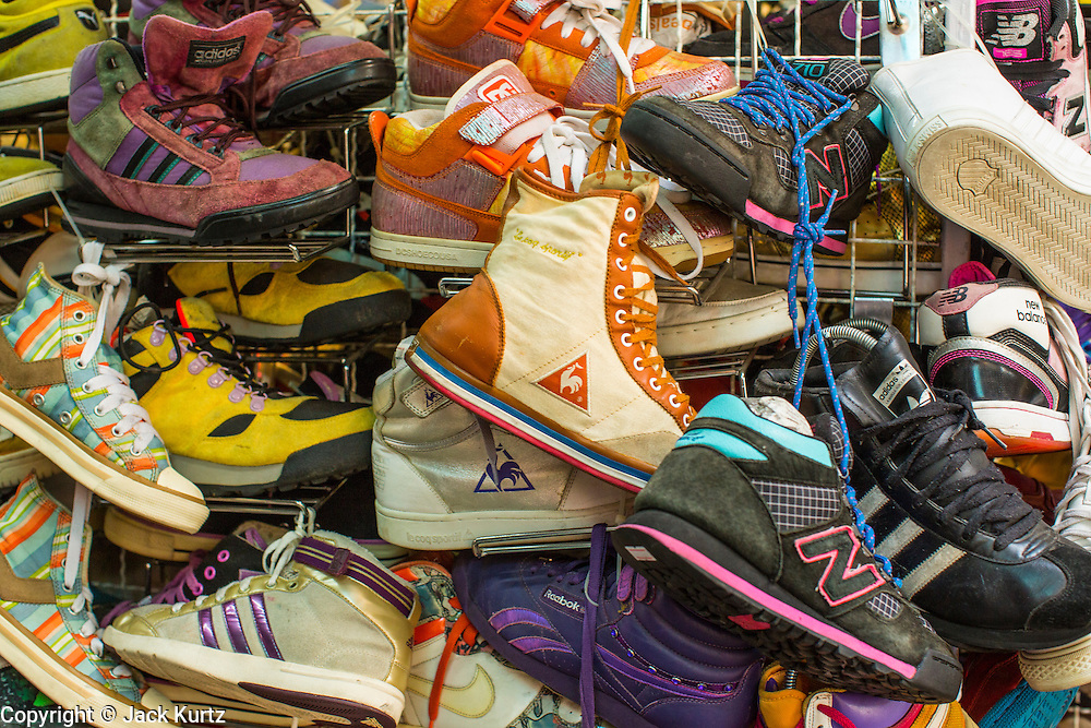 16 FEBRUARY 2013 - BANGKOK, THAILAND:   Shoes for sale in the Chatuchak Weekend Market in Bangkok. Chatuchak Weekend Market in Bangkok is reportedly the largest market in Thailand and the world's largest weekend market. Frequently called J.J., it covers more than 35 acres and contains upwards of 5,000 stalls.    PHOTO BY JACK KURTZ