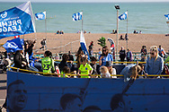 Players families on one of the open top buses during the Brighton & Hove Albion Football Club Promotion Parade at Brighton Seafront, Brighton, East Sussex. United Kingdom on 14 May 2017. Photo by Ellie Hoad.