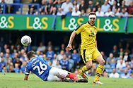 Oxford United Defender, Tony McMahon (29) beats Portsmouth Midfielder, Gareth Evans (26) to the ball during the EFL Sky Bet League 1 match between Portsmouth and Oxford United at Fratton Park, Portsmouth, England on 18 August 2018.