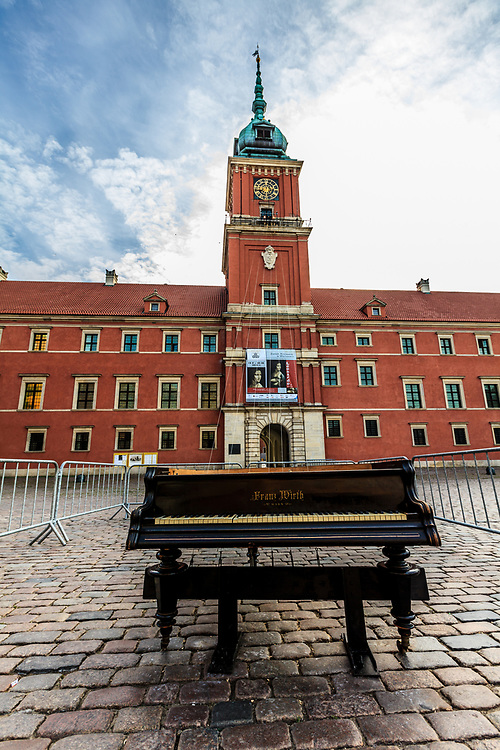Grand piano in front of Royal Castle in Warsaw, Poland. Warsaw is an outstanding music city in Europe. Throughout the calendar, there are cultural festivals to be enjoyed, like the Chopin International Piano Competition, Mozart Festival and Summer Jazz Days.