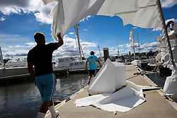 October 8, 2016 - St. Augustine Beach, Florida, U.S. - WILL VRAGOVIC       Times.Blake Shatto, 21, walks under the tattered sail of a sunken sailboat at the Conch House Marina Resort in the aftermath of Hurricane Matthew in St. Augustine Beach, Fla. on Saturday, Oct. 8, 2016. (Credit Image: © Will Vragovic/Tampa Bay Times via ZUMA Wire)