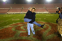 Jack Gruber and Amy Kinsella engaged at the 50-yard line of the Rose Bowl following the 2002 NCAA National Championship football game (Miami 37-Nebraska 14).