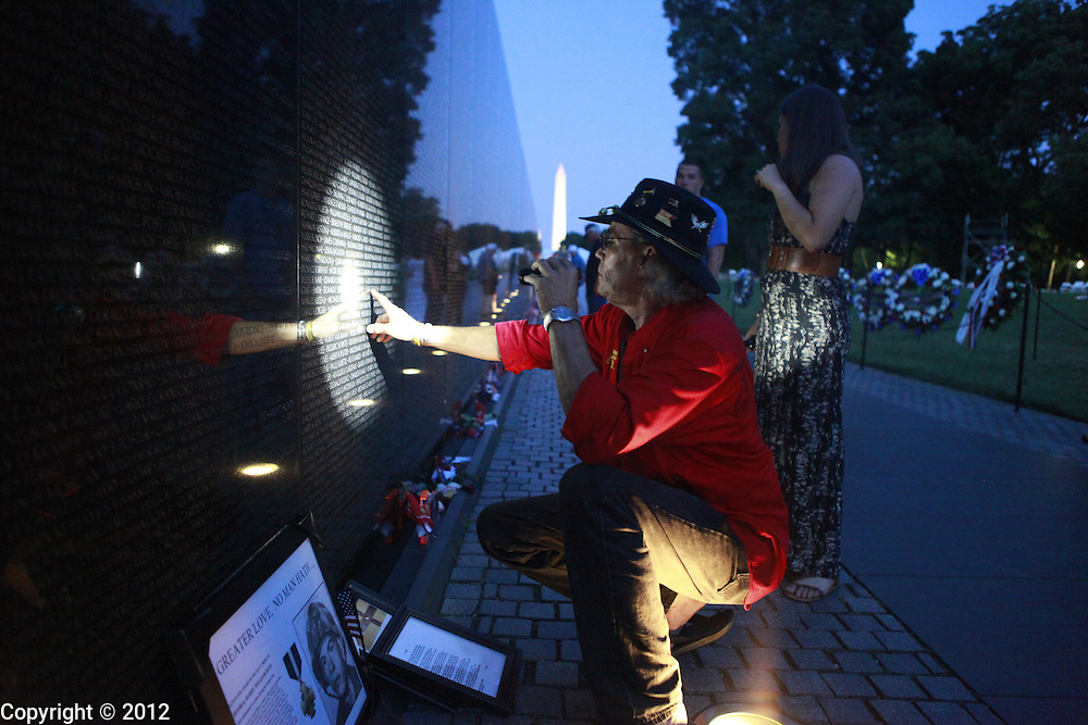 Joe Nave looks for his father Billy Joe Nave's name on the Vietnam Veterans Memorial Wall. Bill Joe Nave, who served in C Troop, 1st Squadron, 9th Cavalry, was killed in a helicopter crash June 27, 1966.