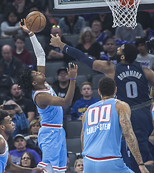 March 19, 2018 - Sacramento, CA, USA - Sacramento Kings guard De'Aaron Fox (5) picks up a defensive rebound against the Detroit Pistons center Andre Drummond (0) during their game at the Golden 1 Center Monday, March 19, 2018 in Sacramento, Calif. The Pistons won, 106-90. (Credit Image: © Hector Amezcua/TNS via ZUMA Wire)