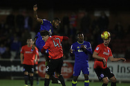 AFC Wimbledon striker Tyrone Barnett (23) heads the ball close to goal during the EFL Trophy match between AFC Wimbledon and U23 Brighton and Hove Albion at the Cherry Red Records Stadium, Kingston, England on 6 December 2016. Photo by Stuart Butcher.