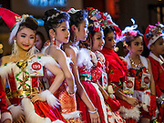 17 SEPTEMBER 2015 - BANGKOK, THAILAND: Participants in the Santa pageant on stage at the World Santa Claus Congress. Twenty-six Santa Clauses from around the world are in Bangkok for the first World Santa Claus Congress. The World Santa Claus Congress has been an annual event in Denmark since 1957. This year's event, hosted by Snow Town, a theme park with a winter and snow theme, hosted the event. There were Santas from Japan, Hong Kong, the US, Canada, Germany, France and Denmark. They presented gifts to Thai children and judged a Santa pageant. Thailand, a Buddhist country, does not celebrate the religious aspects of Christmas, but Thais do celebrate the commercial aspects of the holiday.    PHOTO BY JACK KURTZ