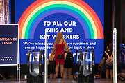 Rainbow for key workers as the Coronavirus lockdown measures are set to ease further, the west end starts to fill with people as they return to the shopping district on Oxford Street and the quiet city starts coming to an end on 22nd June 2020 in London, England, United Kingdom. As of today the government has relaxed its lockdown rules, and is allowing some non-essential shops to open with individual shops setting up social distancing queueing systems.