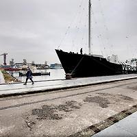 Nederland, Amsterdam , 17 november 2013.<br /> Het Veronica schip ligt aangemeerd bij het NDSM terrein in Amsterdam Noord bij de IJkantine.<br /> Het zendschip Veronica komt midden november naar het NDSM-eiland in Amsterdam. Het volledig gerestaureerde schip krijgt een vaste ligplaats.<br /> Bij het NDSM-eiland zal het schip te huur zijn voor feesten en partijen, wellicht zullen er ook radio-uitzendingen worden verzorgd.<br /> In 1975 in beslag genomen door de Radio Controle Dienst en de politie en ze werd verkocht aan een uitbater in Antwerpen die er een feestschip van maakte. Nadat het feestbedrijf failliet ging, was er sprake van sloop, maar een Nederlands bedrijf in Groningen kocht het schip op en renoveerde haar volledig.<br /> <br /> Foto:Jean-Pierre Jans
